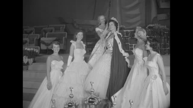 CU Lee Ann Meriwether smiling crown on / various shots contestants walking the runway in bathing suits and sashes with states' names / shots of...