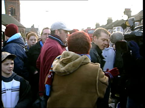 lee bowyer west ham debut/matches itn london upton park woman shouting at west ham fans as taking part in 'west ham fans united against racism'... - west ham fc stock-videos und b-roll-filmmaterial