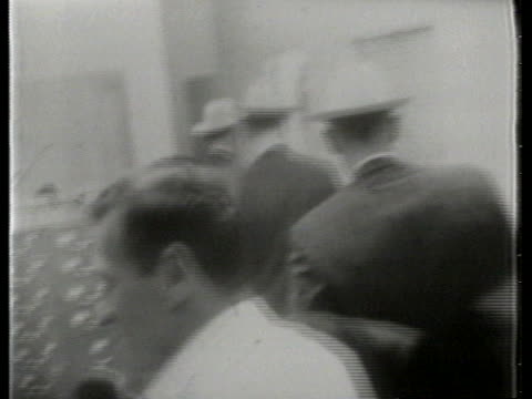 lee harvey oswald, suspected assassin of us president john f. kennedy, walks with police. - assassination of john f. kennedy stock videos & royalty-free footage