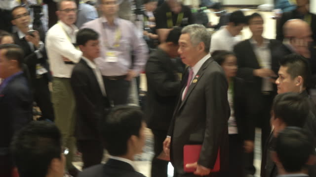 lee hsien loong singapore prime minister walks to a meeting during the association of southeast asian nations summit the laotian capital vientiane - association of southeast asian nations stock videos & royalty-free footage