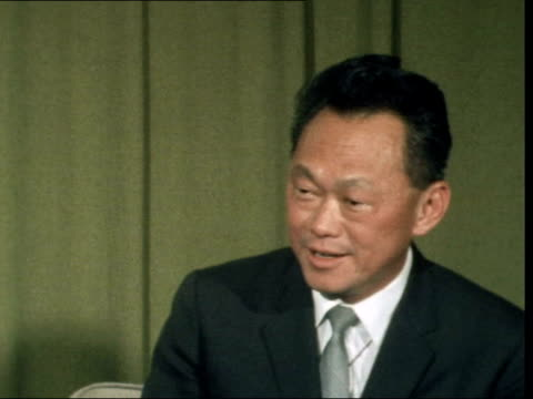 """lee kuan yew arrives in london:; england: london: lap : int and lee kuan yew sof: """"even if you sold no arms to south... - peter snow stock videos & royalty-free footage"""