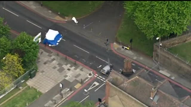 body laying in church ahead of funeral r22051307 london woolwich forensics tent erected at the scene of the murder of lee rigby - ウールウィッチ点の映像素材/bロール