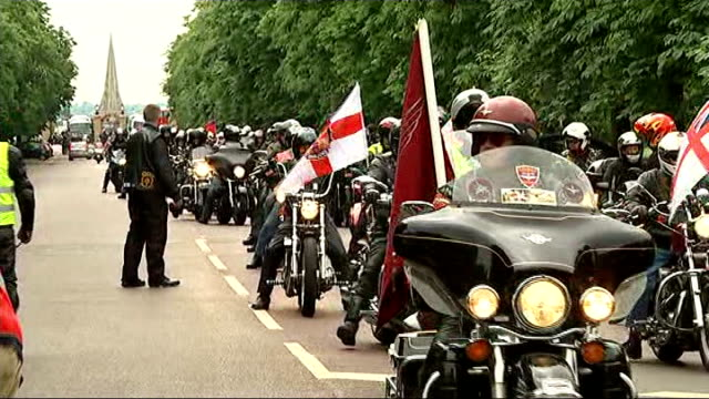 first anniversary ride of respect england london greenwich ext bikers gathered / biker group ride along road past camera / rider talks to steward as... - biker jacket stock videos and b-roll footage