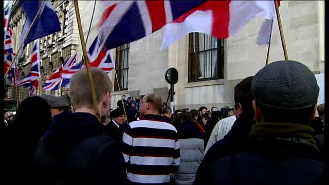 Michael Adebolajo and Michael Adebowale sentenced Men chanting 'scum off our streets' People standing witrh Union Jack flags Close up shot Union Jack...