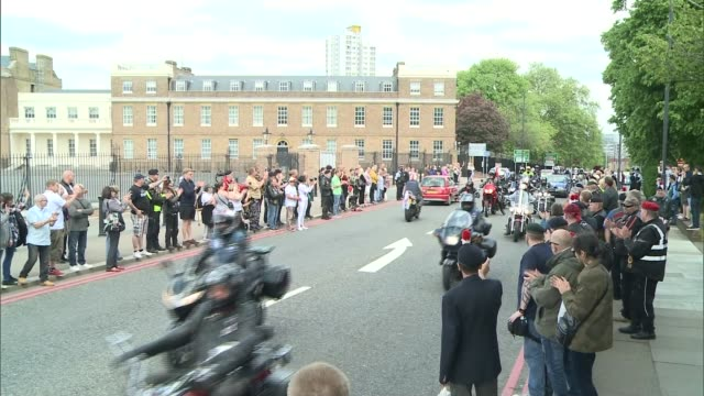tributes paid by family and friends on 3rd anniversary london woolwich ext various shots bikers on large motorbikes along some with union jack flags... - itv london tonight weekend点の映像素材/bロール