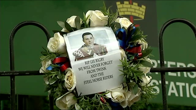 woolwich attack first anniversary london woolwich ext wreath with picture of lee rigby on fence outside army barracks - lee rigby stock videos & royalty-free footage