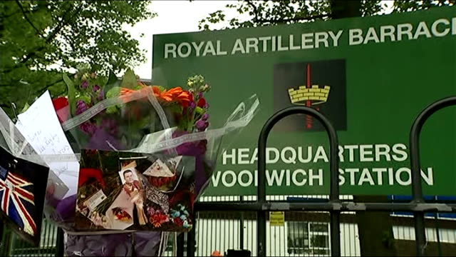 woolwich attack first anniversary london woolwich ext variosu of flowers floral tributes and photographs outside royal artillery barracks - ウールウィッチ点の映像素材/bロール