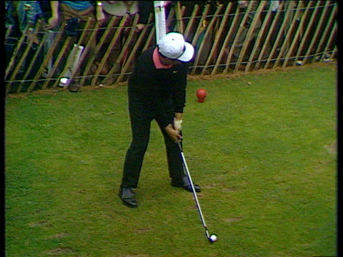 lee trevino hits great tee shot to within 3 feet of pin on 14th hole world matchplay championship final - pga world golf championship stock-videos und b-roll-filmmaterial