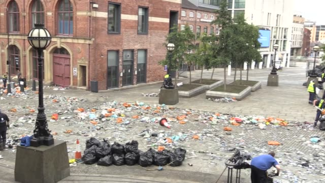 leeds city council staff clean up bottles and cans after leeds united fans gathered in millennium square to celebrate their team winning the... - trophy stock videos & royalty-free footage