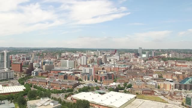 leeds city skyline aerial tracking shot from south - leeds stock videos & royalty-free footage