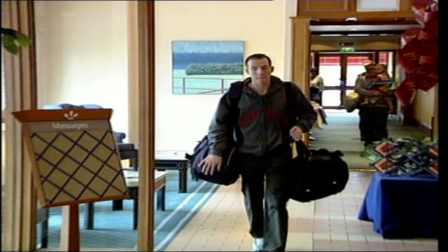 Retrial ordered ITN ENGLAND Yorkshire Hull Lee Bowyer walking through hotel foyer EXT Bowyer putting luggage into car gets into car car away