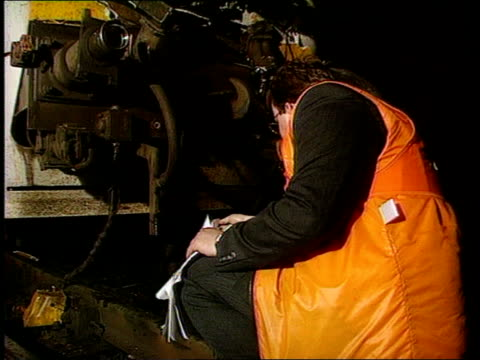 Leeds train crash / Man falls to death from train 1300 Yorks Leeds MS Investigators examing front of InterCity train damaged in collision with local...