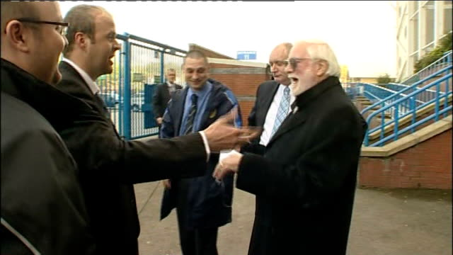 Ken Bates Departing Elland Road ENGLAND Leeds Elland Road EXT Ken Bates departs through gates of Elland Road stadium whilst talking to unidentified...