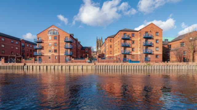 leeds waterfront and apartment on the river aire in leeds, yorkshire -4k time-lapse - leeds stock videos & royalty-free footage