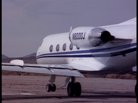 A leer jet takes off from a desert runway.