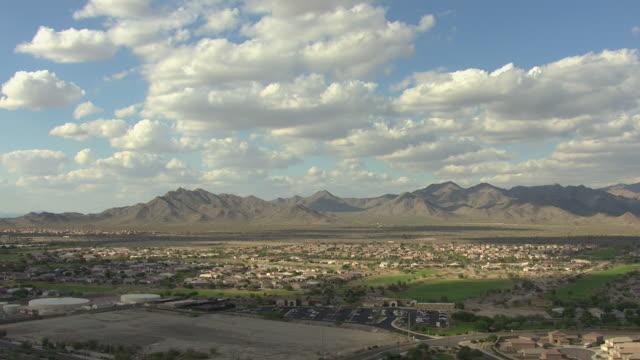 WS AERIAL Left over suburbs in Phoenix Basin / Arizona, United States
