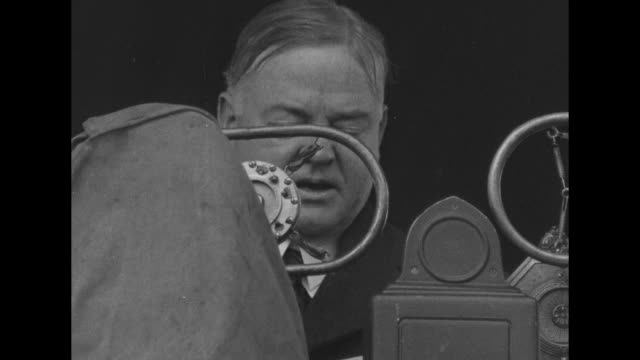 left profile of president herbert hoover / crowd / hoover speaks from behind large microphone / plaque on monument to improved navigation on the ohio... - herbert hoover us president stock videos & royalty-free footage