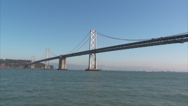 san francisco bay, san francisco-oakland bay bridge, fog & hills bg. suspension, cantilever, truss, infrastructure. - suspension bridge stock videos & royalty-free footage