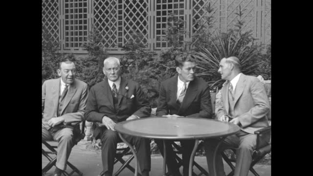 Left to right at garden table at the Biltmore Hotel Billy Gibson George Tunney's manager William Muldoon chairman of the New York State Athletic...