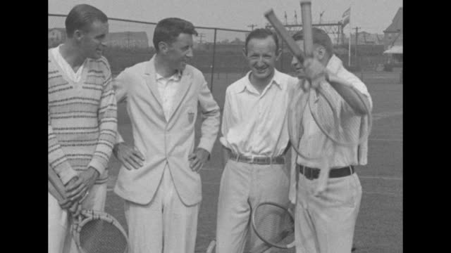 left to right men's doubles tennis players bill tilden, norris williams, bill johnston and vincent richards pose for photo opportunity on court at... - davis cup stock-videos und b-roll-filmmaterial