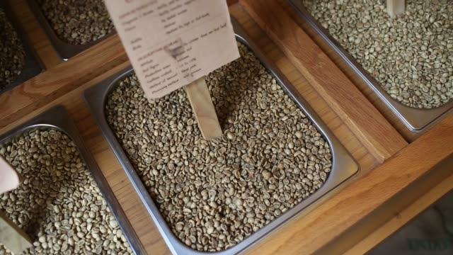 left to right pan of robusta and arabica coffee beans in a container inside a trung nguyen corp coffee store in hanoi vietnam on saturday may 31 pull... - caffeine molecule stock videos & royalty-free footage