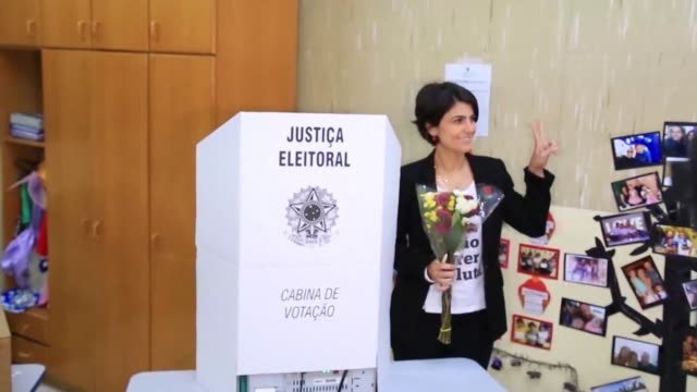 leftist vice presidential candidate and state lawmaker from the communist party manuela d'avila casts her vote in porto alegre - alegre stock-videos und b-roll-filmmaterial