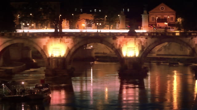 left-to-right pan of illuminated ponte sant'angelo at night - サンタンジェロ橋点の映像素材/bロール