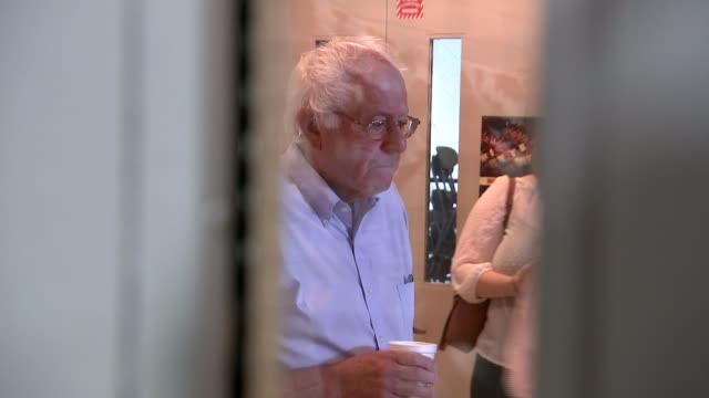 left-wing democrat candidate bernie sanders on campaign trail; new hampshire: display board showing badges with slogans 'bern baby bern' and 'feel... - placard stock videos & royalty-free footage