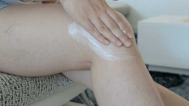 leg massage with medicine - thigh stock videos & royalty-free footage
