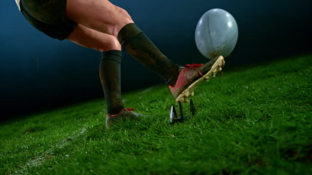slo mo leg of a female rugby player in black outfit kicking the ball - kicking stock videos & royalty-free footage