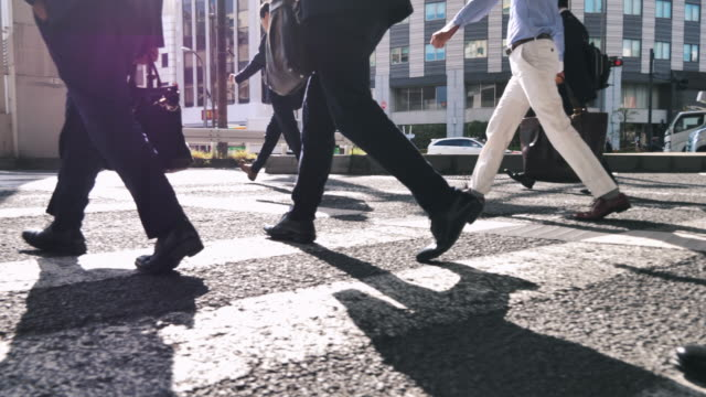leg of business person crossing the road in crowded downtown - pavement stock videos & royalty-free footage