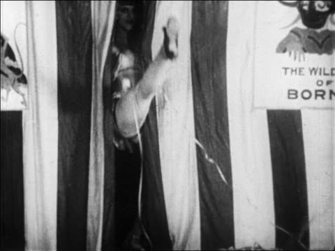 B/W 1928 leg of dancer in skimpy outfit entering from curtain in nightclub floorshow / newsreel