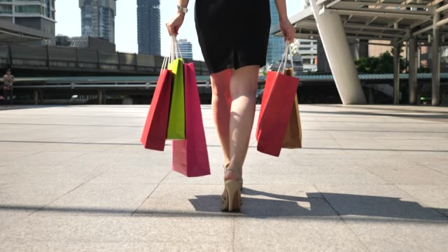 Leg of Woman walking with shopping bags