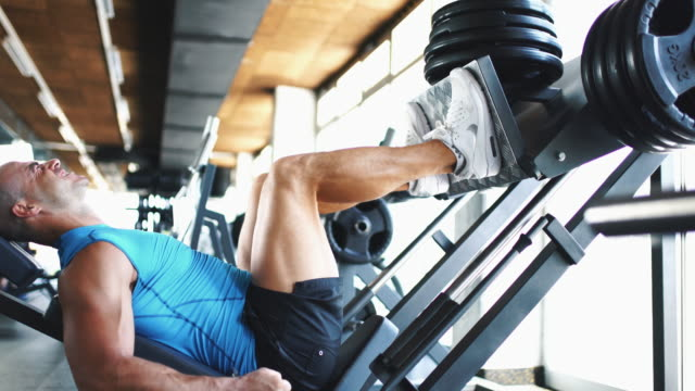 leg press exercise. - human leg stock videos & royalty-free footage