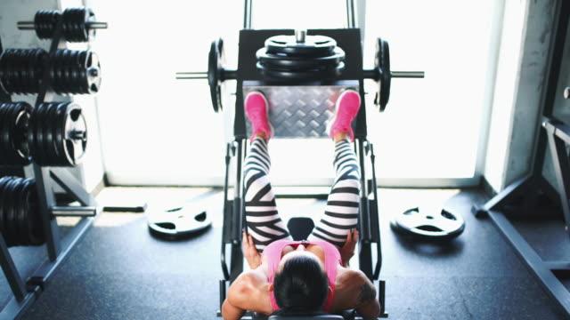 leg press exercise. - leg press stock videos & royalty-free footage