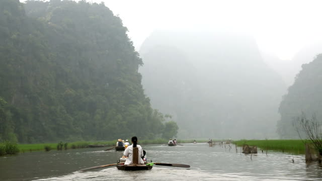 Leg rowing local Vietnamese Tam Coc nr Ninh Binh nr Hanoi North Vietnam