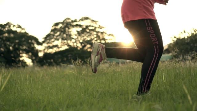 leg shot woman running slow motion sun light