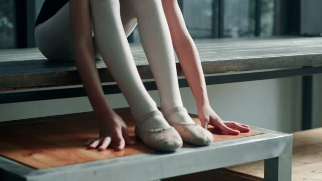 leg stretching after ballet class - ballet dancing stock videos & royalty-free footage