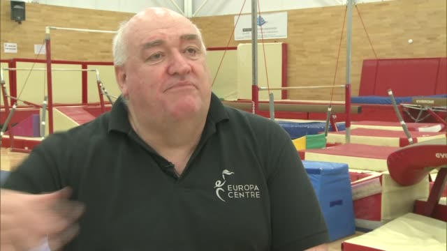 legacy of london 2012 olympic games england kent crayford int len arnold giving instructions at gymnastics club sot girl jumping on trampoline girl... - horizontal bar stock videos and b-roll footage