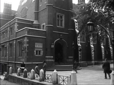 annual general meeting of the bar; england: london: middle temple: temple hall: ext shot pan down temple hall: m. holland arrives: cms others arrive:... - annual general meeting stock videos & royalty-free footage