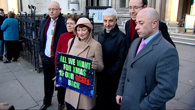 legal challenge launched over gcse english results england london high court ext group of campaigners standing outside court with sign 'all we want... - 一般教育証明試験点の映像素材/bロール
