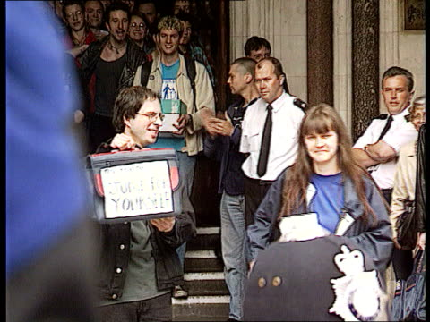 legal costs in libel case lib london high court environmental protestors dave morris and helen steel outside court after libel defeat by mcdonalds - mcdonald's stock-videos und b-roll-filmmaterial