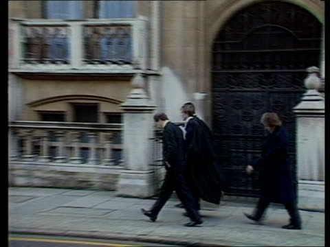 legal reform bill changes; itn lib lincoln's inn side group barristers along street r-l pull out bv barrister along through park - reform stock-videos und b-roll-filmmaterial