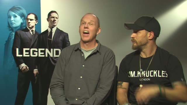 interviews england london int brian helgeland and tom hardy interview sot on which of the twins was easier to play on why he wanted tom hardy for... - eastenders stock videos and b-roll footage