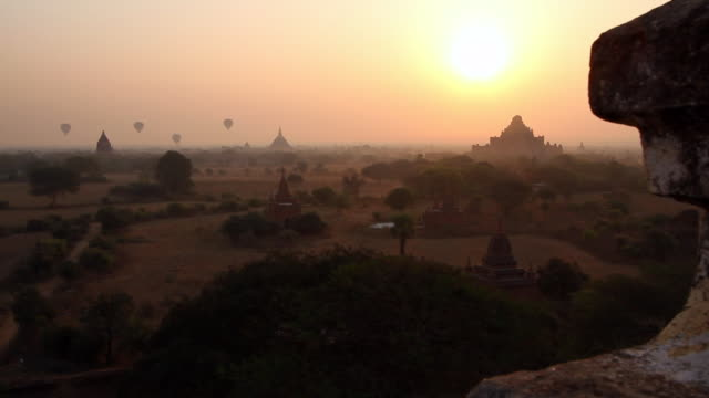 legendary buddhist temples in bagan surrounded by hot air balloons - theravada stock videos & royalty-free footage