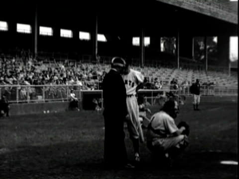 stockvideo's en b-roll-footage met legendary entertainers jerry lewis and dean martin wearing new york giants baseball uniforms and caps on baseball field in los angeles; jerry lewis... - 1955