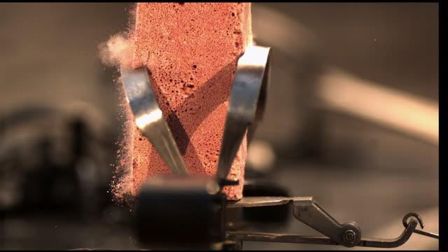 a leg-hold trap breaks a brick. - brick stock videos & royalty-free footage