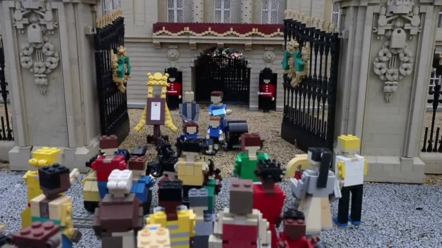 Lego figures of the Duke and Duchess of Cambridge and their family outside the Buckingham Palace model at Legoland Windsor Resort n Berkshire which...
