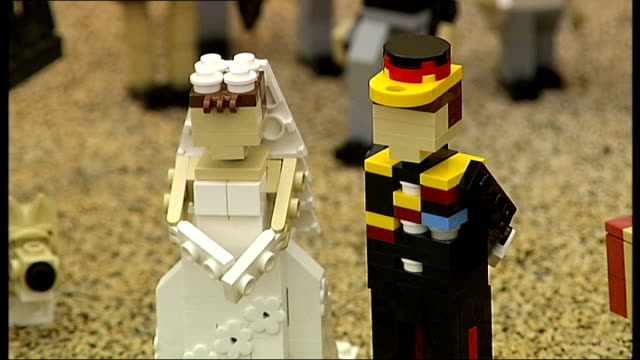 legoland replica royal wedding; england: berkshire: windsor: ext lego version of royal wedding between prince william and kate middleton lego kate... - celebrities video stock e b–roll