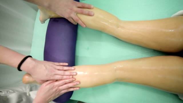 legs and buttocks massage - beauty treatment stock videos and b-roll footage